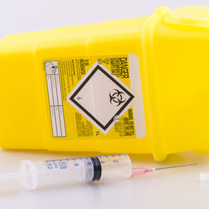 Hyperdermic needle and sharps box